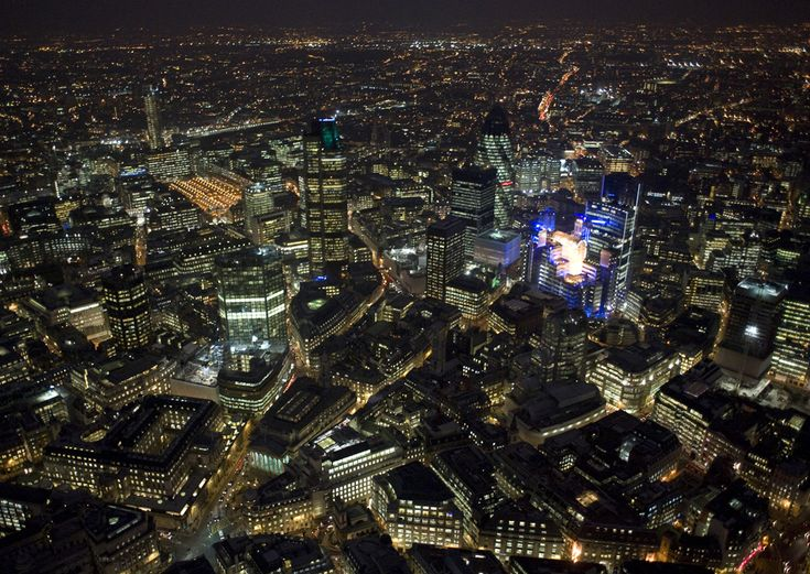London's financial district, featuring the Lloyd's Building and The Gherkin. (© Jason Hawkes) #
