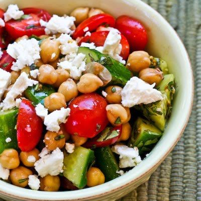 Cucumber and tomato salad with marinated garbanzo beans, feta and herbs