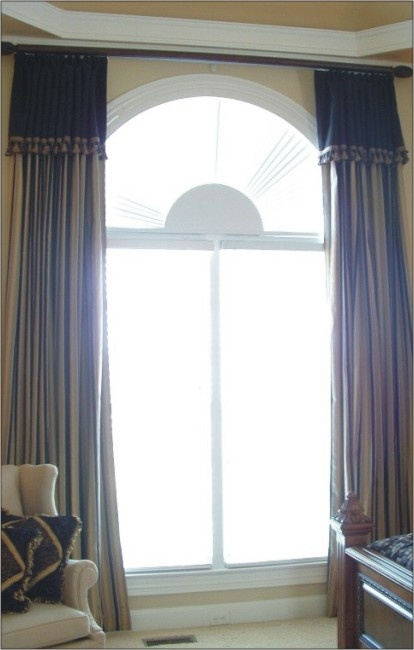 Pin by rebecca forty on window treatments drapes for Arched bay windows