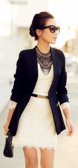 white lace dress, blue casual jacket and black purse