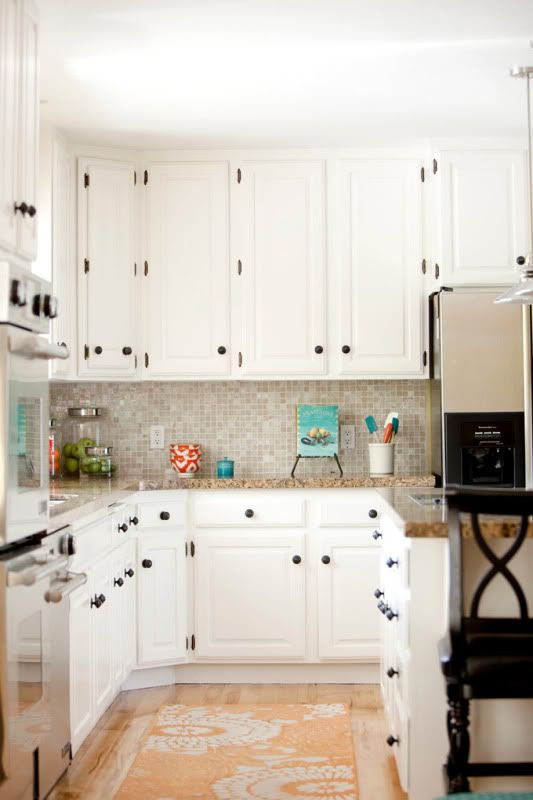 Dark pulls and rug white kitchen cabinets inspiration for Black kitchen inspiration