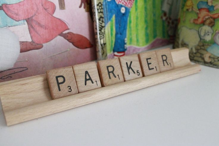 Adorable - spell out baby's name in Scrabble letters as nursery decor! (Hot glue for safety)