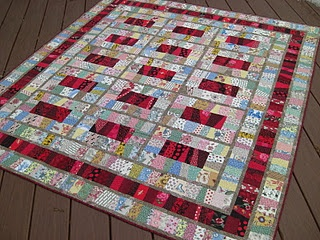 String quilt! The red border and inner blocks make this one unique.