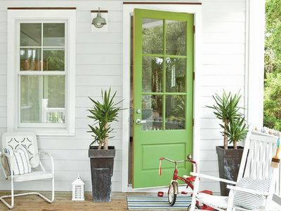Front door is such a fresh, fun green! Love that the entry is simple and cheery.
