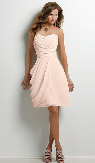 Bridesmaids dresses but with different shade of pink.