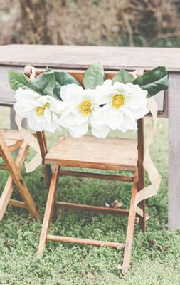 Gorgeous chair decor by Stockroom Vintage- magnolias are perfect for a southern wedding!
