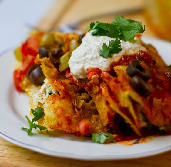 It's enchilada o'clock! Let there be Cashew Cheese and Kale Enchiladas Rojas (and margaritas)!