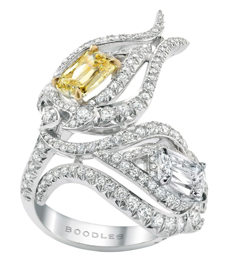 Boodles Damask Rose ring with two Ashoka cut diamonds: 1 intense yellow and 1 white within a brilliant cut diamond set curled petal mount in platinum.