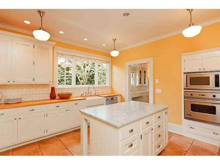White cabinets + white tile backsplash + yellow walls = nice and