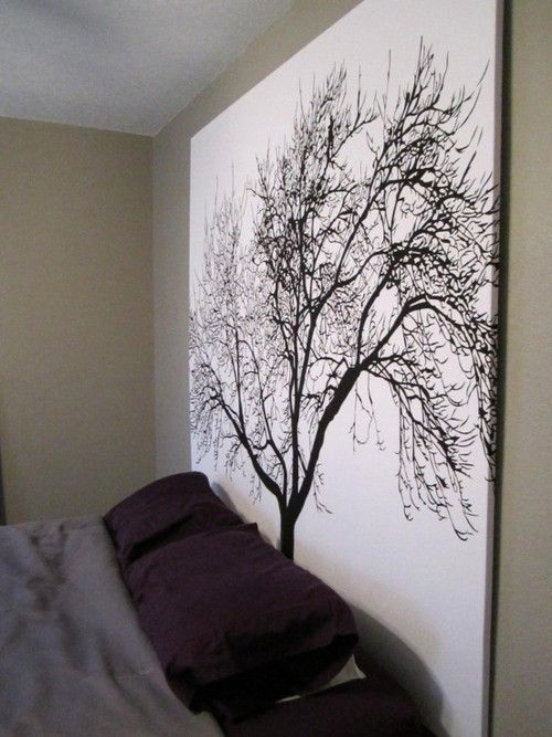 Staple a shower curtain to a wooden frame for inexpensive large scale artwork.
