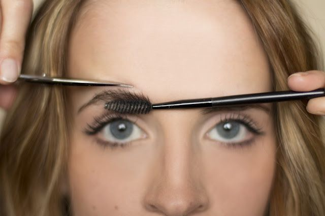 trimming eyebrows