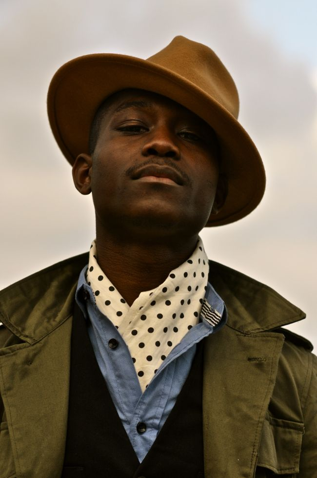 Polka dots done in a masculine way (something about the chambray setting them off and the camel of the hat?)