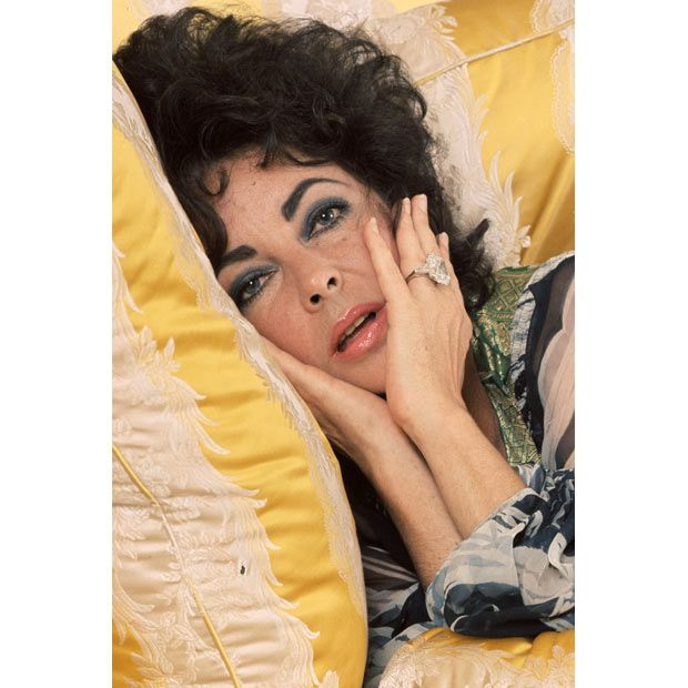 Elizabeth Taylor w. diamond ring. 1976. Assuming the humor is unintentional.
