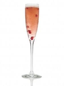 A simple yet sophisticated cocktail: champagne, a dash of your favorite fresh juice (this one has passion fruit), raspberries for garnish. http://www.truthartbeauty.com/blog/featured/hosting-an-oscar-party/