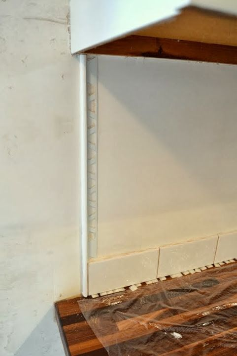 Your tiling dilemma, solved! How to neatly finish off the ends of a run of subway tile under cabinetry.