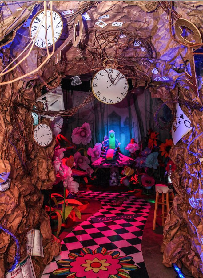 Alice in wonderland rabbit hole library decorations for Decoration hole