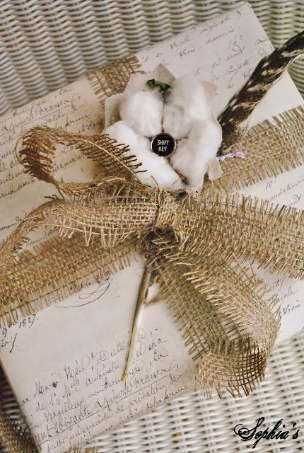 I'm in love with how she embellished this present-the cotton and feather are perfection! Lots of other inspiration too.