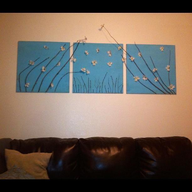 "Tree branch ""paintings"" - boards, paint, tree branches, fake flowers - waalah!"