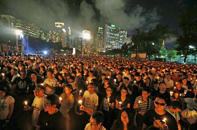 Hong Kong vigil marks Tiananmen anniversary Tens of thousands in Hong Kong defy mainland China by holding vigil marking bloody crackdown in ...