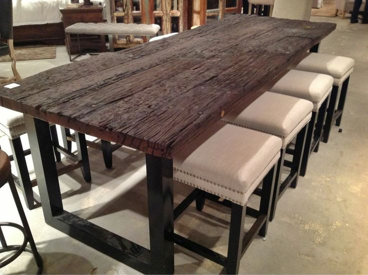 look at this chic and contemporary reclaimed wood dining room table