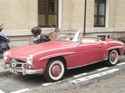 Vintage pink Mercedes, parked on a Parisian street.