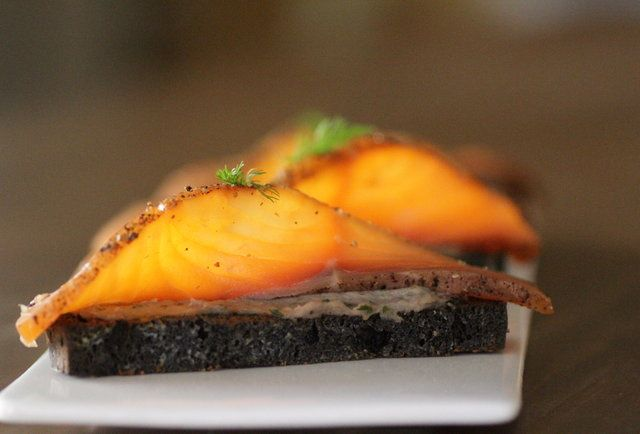 Pastrami smoked salmon on top of bluefish pate and squid ink infused ...