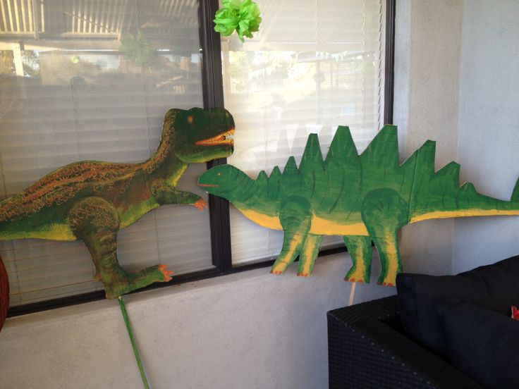 Dinosaur cut outs designed and painted by Dino Daddy and Dino Diva