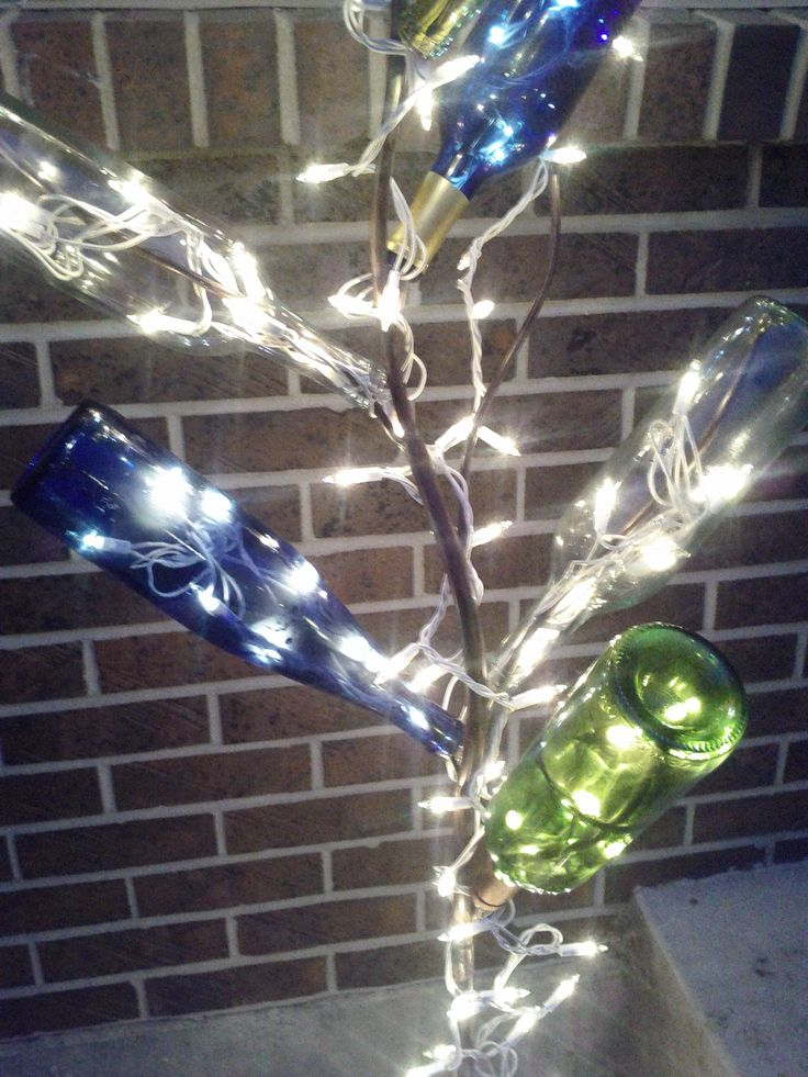 Lighted bottle tree christmas crafts pinterest for Diy solar wine bottle lights