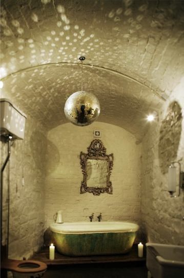Yes! A disco ball in the bathroom  Oh, did I mention the bathroom is located in an Irish castle?  (via Abscond to a Castle | Apartment Therapy Los Angeles)