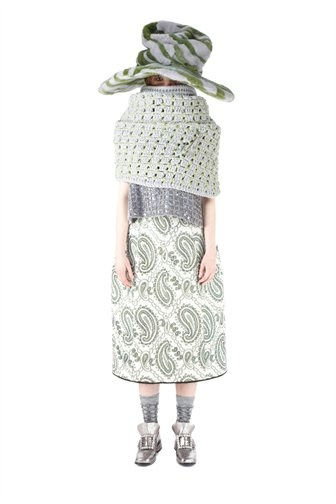 $1,800 for WTF??  I will never understand fashion! @TimGunn please explain!  {Hand crocheted waffle-knit wool shawl in an array of colors. Embellished with removable oversized metal safety pin. 100% Wool with Nylon and Rayon.*The skirt from this look can be purchased at Marc Jacobs boutique stores.}