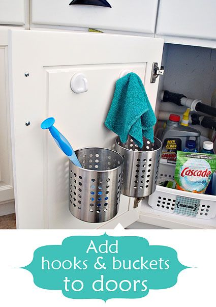 use hooks inside cabinet doors for dish rags to dry & add buckets to doors for sponges and tools #kitchen #organize