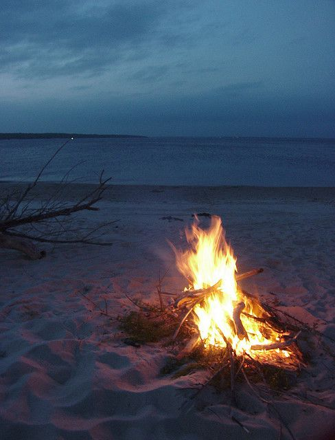 A summer evening at the beach, surrounded by friends and family, with a big fire to keep everyone warm :)