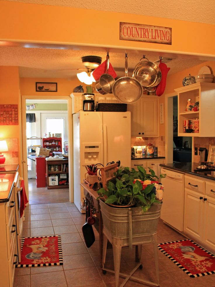 either want a red kitchen with yellow accents or a yellow kitchen
