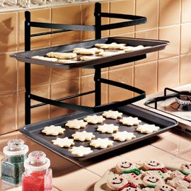 I have this wonderful baking rack - a real space saver!  Good for prepping pan after pan of cookies & good for cooling the racks that come out of the oven!