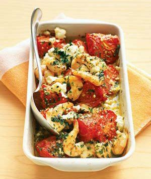 Roasted Tomatoes With Shrimp and Feta|Use up ripe summer tomatoes in this herby, garlic-infused dish that's rich with Greek flavors. Serve warm with crusty bread for mopping up all the delicious juices.