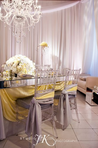 cloud 9's Custom made mirror top table complete with ghost chiavari chairs