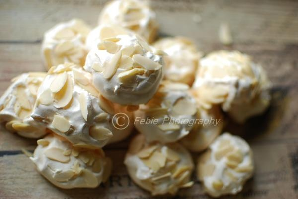 dipped almond meringues recipe myrecipes com chocolate dipped almond ...