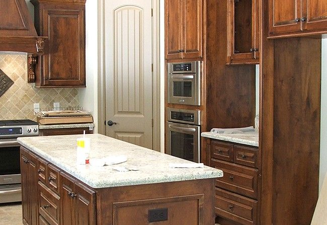like Dark Knotty Alder wood cabinets  Home Kitchens  Pinterest