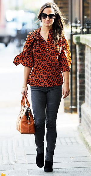 Pippa paired a heart-print blouse with her go-to French Connection jeans and Modalu bag.