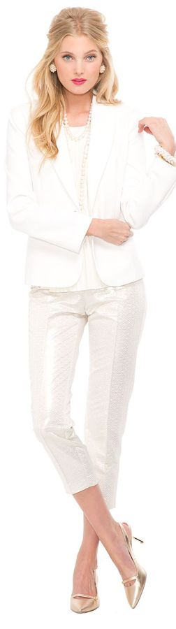 sparlkling white pants with white coat and shirt