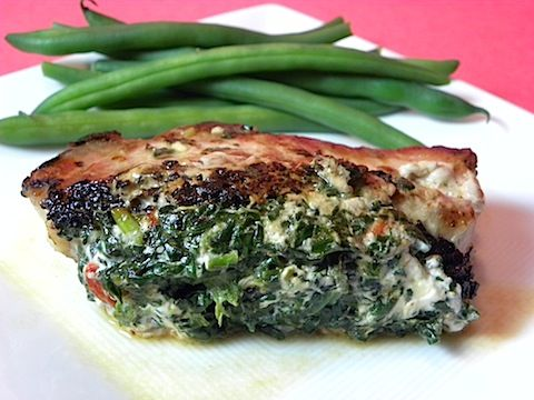 Pork chops stuffed with sun-dried tomatoes and spinach.. yum.