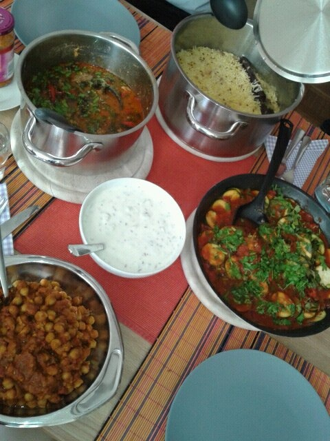 lamb-spinach curry (saag gosht), a courgette curry, a chickpeas ...