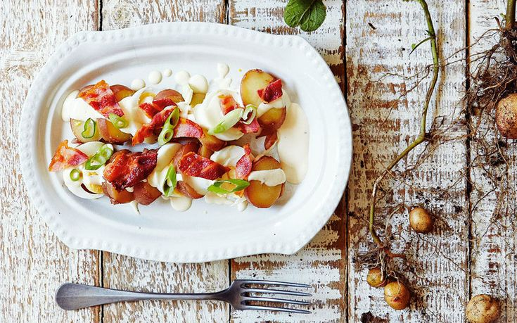 ... potato salad with boiled eggs, bacon, and a creamy mayonnaise dressing