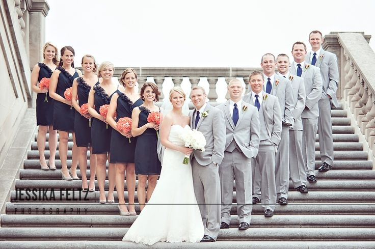 I really like the way they inverted the usual 'wedding party picture' by placing the bride and groom in the front.