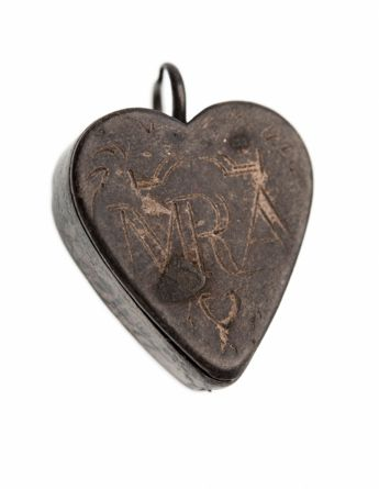 Silver heart-shaped reliquary in two pieces. Used as protection from evil.