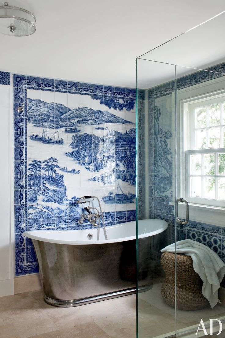 A bath in Shelter Island, New York, sports a blue-and-white mural by Chelsea Arts Tile + Stone.