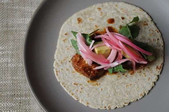 slow cooked pork tacos. pickled red onions. favorite.