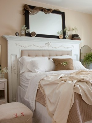 old fireplace mantle as a headboard
