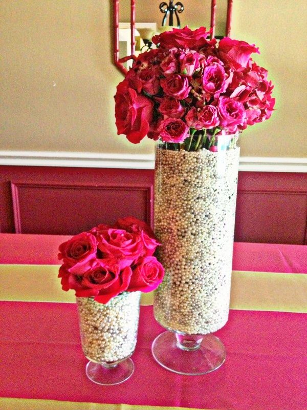 Hot pink roses in pearls centerpieces the wedding bells