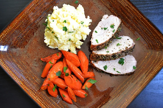 herb roasted pork dinner complete with 2 sides.
